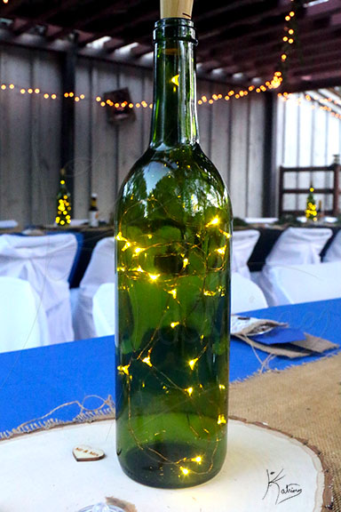 Bottle with Lights on Wedding Table